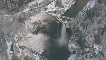Fly over snowy Snoqualmie Falls