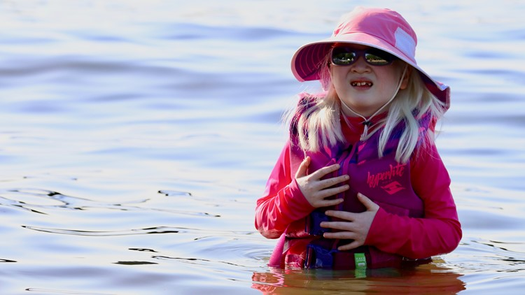 Sarah Carollo, 6, swims at Sammamish Lake State Park in Issaquah on May 13, 2018. (Photo: Taylor Mirfendereski | KING 5)