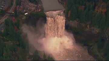 RAW: SkyKING flies over raging Snoqualmie Falls
