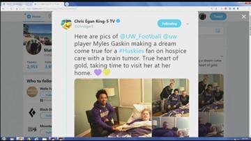 Husky football players visit fan on hospice care
