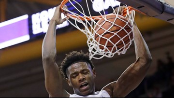 No. 25 Washington rebounds from 1st loss, tops Maine 72-53