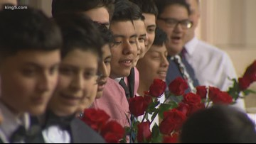 Group of middle school boys in SeaTac give Valentines to entire school