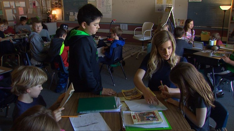 Teacher Amy Slaughter helps a student in her third-grade class at Strafford Primary School in West Linn, Oregon.