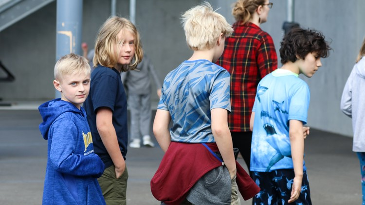 Jake Vandell (left) stands in line next to his friends during recess at the Hamlin Robinson School on June 1, 2018. (Photo: Taylor Mirfendereski   KING 5)