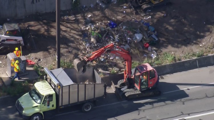 Crews clean up homeless encampments near I-90 in Seattle after rock-throwing incidents