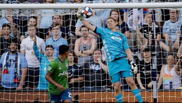 Russell's hat trick helps Sporting KC beat Sounders, snap skid