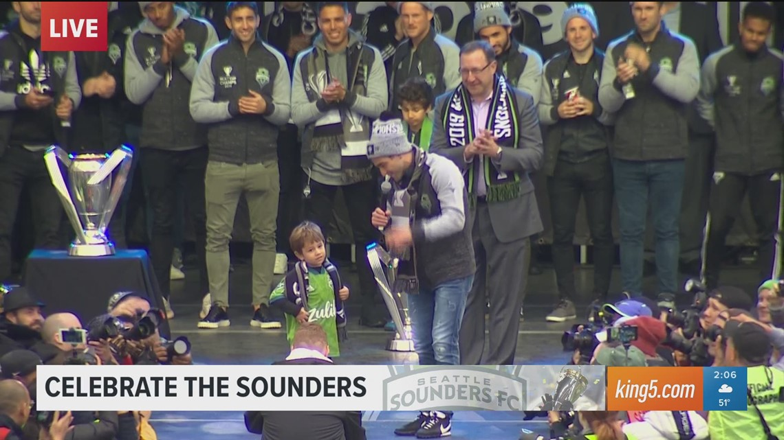 Seattle Sounders team captain Nicolás Lodeiro dances with his son at championship rally