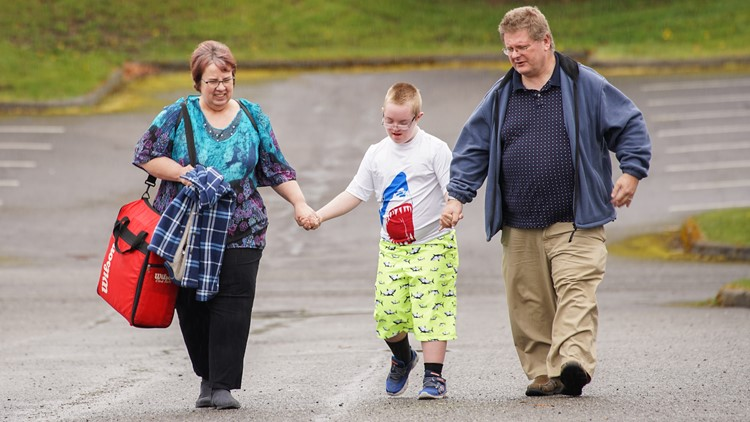 Rob and Sandy Clayton take their 13-year-old son Sam to his swim lesson at a Federal Way community center on April 5, 2018.  (Photo: Taylor Mirfendereski | KING 5)