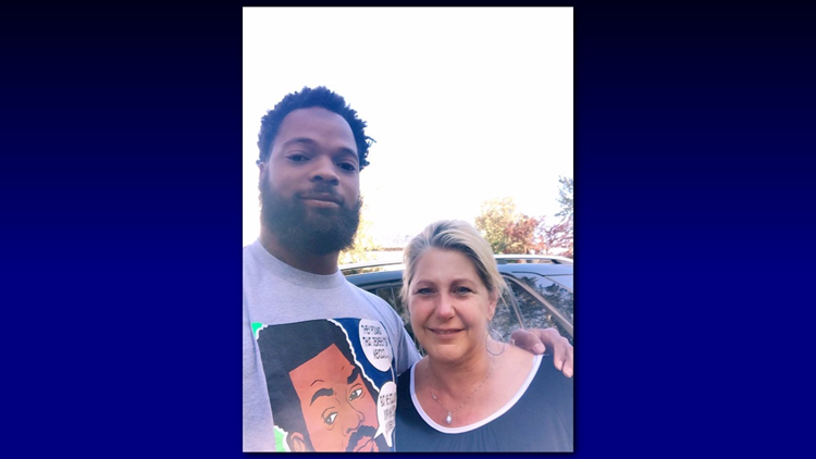Seattle Seahawks defensive end Michael Bennett and Dayna Coats. Coats wrote an emotional Facebook post about the conversation Bennett had with a group of military veterans and with her outside Seahawks headquarters. (Credit: Dayna Coats)