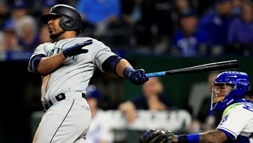 Encarnacion homers twice in same inning, Mariners roll Royals 13-5