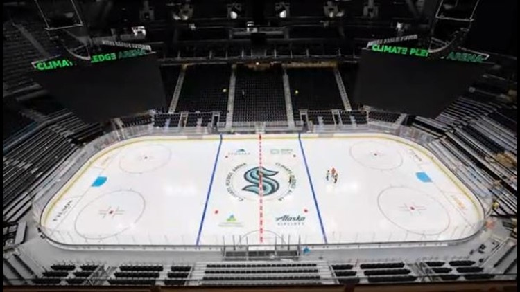 Seattle Kraken fan awaits seat assignment during finishing touches on Climate Pledge Arena