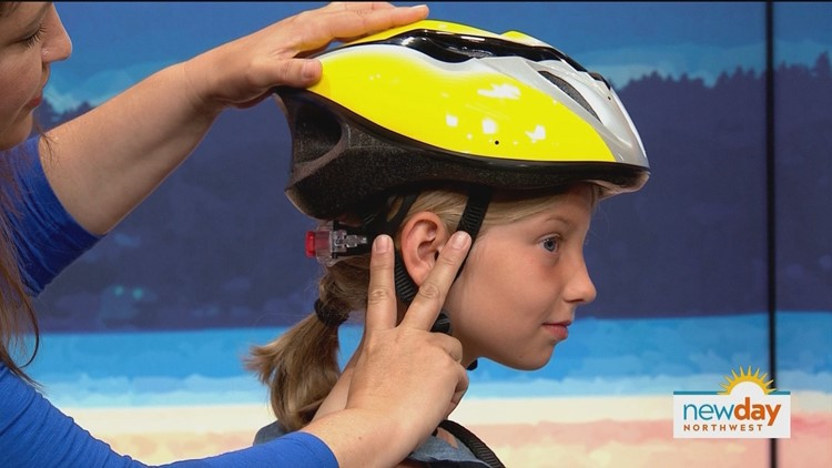 "When a helmet fits properly, straps are even, form a ""Y"" under each earlobe, and lay flat against the head."