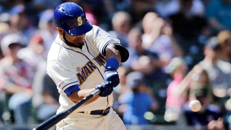 Encarnacion stars with glove and bat, Mariners top Twins 7-4