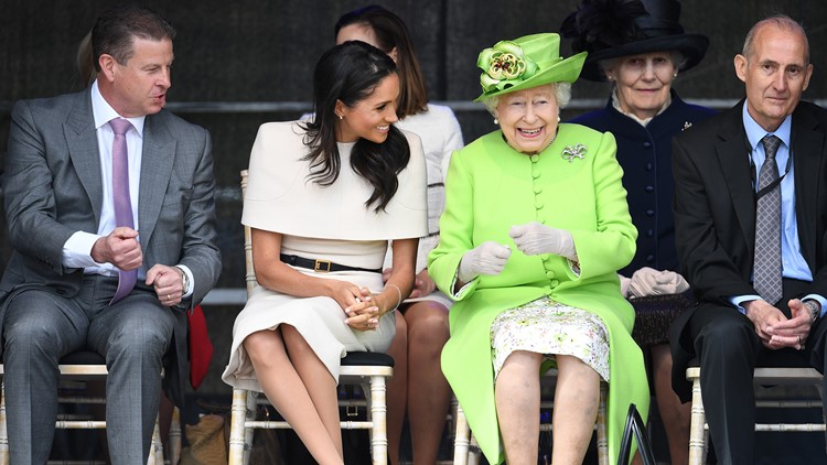 Queen Elizabeth II laughs with Meghan, Duchess of Sussex during a ceremony to open the new Mersey Gateway Bridge on June 14, 2018 in the town of Widnes in Halton, Cheshire, England.