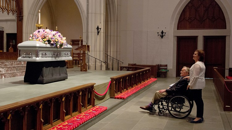 Former President George H. W. Bush looks at the casket with his daughter Dorothy 'Doro' Bush Koch as they wait for the mourners during the visitation of Barbara Bush at St. Martin's Episcopal Church Friday, April 20, 2018, in Houston, Texas.
