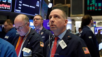 Stocks fall again amid coronavirus concern in Wall Street's worst week since 2008