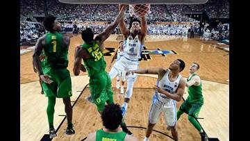 North Carolina fends off Oregon to reach NCAA title game