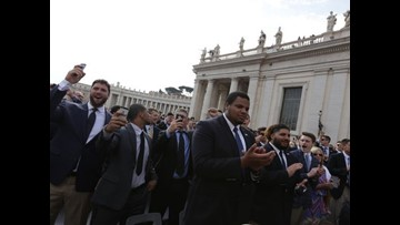 Jim Harbaugh gives helmet, shoes to Pope